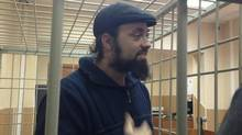 Greenpeace International activist Alexandre Paul of Canada attends a bail hearing at the Murmansk Regional Court, in this Greenpeace handout picture on October 18, 2013. Paul released a letter from Russian prison on Oct. 25, 2013, describing his detention on hooliganism charges. (GREENPEACE/REUTERS)