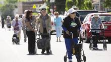 Seniors take part in the St. Hilda's Foundation Snail Strut Walk in Toronto on Thursday. The walk is geared towards people who are 85 years and older with 96 years being the average age. (Michelle Siu/The Globe and Mail)