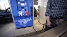 A motorist pumps gasoline at a station in Toronto. (Fred Lum/Fred Lum/The Globe and Mail)