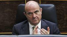 Spain's Economy Minister Luis De Guindos, listens to Spain's Prime Minister Mariano Rajoy's speech during a control session at the Spanish Parliament, in Madrid, Wednesday, July 11, 2012. (Andres Kudacki/AP)