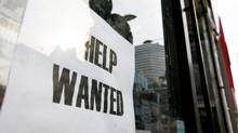 In this file photo, a help wanted sign is posted in a window at a store on Yonge St. in Toronto. (Charla Jones/TheGlobe and Mail)