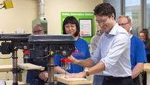 Prime Minister Justin Trudeau displays his woodworking skills as he operates a drill press during a visit to the Nova Scotia Community College in Dartmouth, on April 7, 2017. (Andrew Vaughan/THE CANADIAN PRESS)
