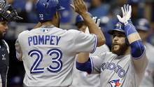 Russell Martin, right, celebrates with Dalton Pompey after hitting a two-run homer for the Toronto Blue Jays during the eighth inning on Sept. 4 against the Tampa Bay Rays. (Chris O'Meara/The Associated Press)