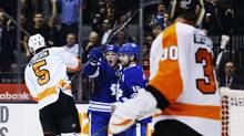 Maple Leafs forward Matt Frattin, left, celebrates his goal with teammate Clarke MacArthur in Toronto on Monday. (MARK BLINCH/REUTERS)