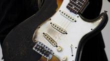 Fender guitars have been used by music legends including Jimi Hendrix, whose charred 1965 Fender Stratocaster was auctioned in 2008. (SUZANNE PLUNKETT/REUTERS)