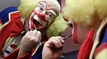 A clown with Garden Brothers Circus touches up his make-up in his Toronto dressing room on February 24, 2000. (KEVIN FRAYER)
