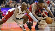 Chicago Bulls Derrick Rose (R) battles for the ball with Toronto Raptors Jarrett Jack during the second half of their NBA preseason basketball game in Toronto, October 20, 2010. REUTERS/Mark Blinch (MARK BLINCH)