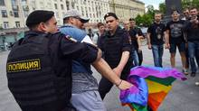 Russian riot police detain an LGBT-rights activist during a rally in Moscow in 2015. Conservative Calgary MP Michelle Rempel described LGBT Chechens as 'one of the most persecuted people in the world right now,' and says coming to their aid is 'a no brainer.' (DMITRY SEREBRYAKOV/AFP/Getty Images)