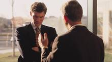 A business executive dressed in a suit confronts an employee and uses hand gestures as he talks. Thinkstock (Thinkstock/Thinkstock)