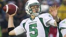 Saskatchewan Roughriders quarterback Drew Willy throws a pass against the Hamilton Tiger-Cats in the first quarter of their CFL football game in Guelph July 27, 2013. (FRED THORNHILL/REUTERS)