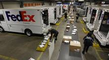 FedEx Corp. reported that its fiscal first quarter earnings fell 1.1 per cent and it also lowered its full-year earnings guidance. (© Fred Prouser / Reuters/REUTERS)