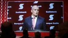 Shareholders and employees watch Scotiabank CEO Brian Porter speak on a screen during the company's annual general meeting in Ottawa on Thursday, April 9, 2015. (Cole Burston/THE CANADIAN PRESS)