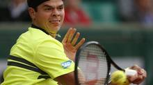 Canada's Milos Raonic returns against Michael Llodra of France in their second round match of the French Open (Petr David Josek/AP)