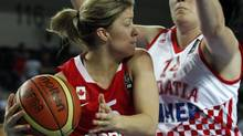 Canada's Teresa Gabriele (L) goes for a basket against Croatia's Luca Ivankovic (R) during their 2012 women's FIBA Olympic Qualifying Tournament in Ankara June 29, 2012. (UMIT BEKTAS/REUTERS)