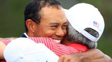 Tiger Woods and Fred Couples (Scott Halleran/2011 Getty Images)