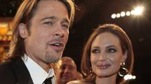 Brad Pitt and Angelina Jolie at the the 18th annual Screen Actors Guild Awards in Los Angeles on Jan. 29, 2012. (LUCY NICHOLSON/Reuters)