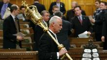 The Mace is removed from the House of Commons chamber on Parliament Hill in Ottawa on Thursday, Dec. 4, 2008 after the governor general's decision to prorogue Parliament. (Sean Kilpatrick/The Canadian Press)