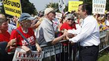 U.S. Senator Ted Cruz greets attendees as he arrives to speak at the Tea Party Patriots 'Exempt America from Obamacare' rally in Washington in this September 10, 2013 file photo. Republican infighting took a nasty turn in the U.S. Senate on September 26, 2013 with Senator Bob Corker accusing fellow conservative Ted Cruz of using the looming fiscal deadline for self-promotion and to endear himself further with Tea Party groups. (JONATHAN ERNST/REUTERS)
