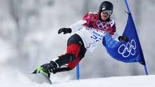 Canadian snowboarder Jasey Jay Anderson makes his way down the men's parallel slalom during qualification February 19, 2014 at the Sochi Winter Olympics. (John Lehmann/The Globe and Mail)