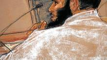 FILE--In this photo of a sketch by courtroom artist Janet Hamlin and reviewed by the U.S. military, Canadian defendant Omar Khadr attends a hearing in the courthouse for the U.S. military war crimes commission at the Camp Justice compound on Guantanamo Bay U.S. Naval Base in Cuba, on July 15, 2009. (Janet Hamlin/Janet Hamlin/AP)