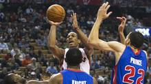 Toronto Raptors forward DeMar DeRozan, back centre, takes a shot past Detroit Pistons guard Rodney Stuckey, left, guard Brandon Knight, front centre, and forward Tayshaun Prince, right, during first half NBA basketball action in Toronto on Wednesday, Feb. 22, 2012. (Nathan Denette/THE CANADIAN PRESS)