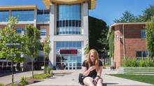 "Ceara Bruce, an English major at Wilfrid Laurier University, relaxes on campus on August 8, 2013. The town of Milton, which had a 56.5-per-cent surge in population from 2006 to 2011, has teamed up with Wilfrid Laurier University on a campus proposal and ""education village"" that has been in the works since 2008. (JENNIFER ROBERTS For The Globe and Mail)"