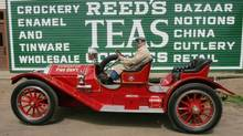 Chris Bamford drives his 1912 Kisselkar Fire Chief's car during the A Dickens of a Festival at Fort Edmonton Park in Edmonton on Sunday, May 22, 2005. (Darryl Dyck/CP)