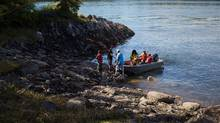 A boat carrying protesters and supplies lands on Lelu Island near Prince Rupert, B.C.in August. (Ben Nelms/Bloomberg)