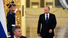 Russian President Vladimir Putin arrives for a meeting of the Presidential Council for Civil Society and Human Rights at the Kremlin in Moscow on Oct. 1, 2015. (YURI KOCHETKOV/AFP/Getty Images)