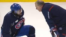 Montreal Canadiens head coach Michel Therrien right, chats with Montreal Canadiens defenceman P.K. Subban during the team's practice Wednesday, May 21, 2014 in Brossard, Que (The Canadian Press)