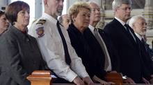 Mayor Ursule Theriault, left, Fire Chief Yvan Charron, Quebec Premier Pauline Marois, Governor-General David Johnson and Prime Minister Stephen Harper attend a memorial service Saturday, Feb. 1, 2014 in L'Isle-Verte, Que. for victims of afatal fire at a seniors' home. (Ryan Remiorz/THE CANADIAN PRESS)