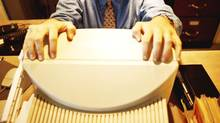 PHOTODISC -- Businessman overwhelmed by computer. Photo: Jules Frazier/PhotoDisc STRESS; FRUSTRATION; WORKPLACE; COMPUTERS; EMPLOYEES; BUSINESSPEOPLE; (Jules Frazier/Corbis Stock photo)