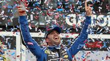 Jimmie Johnson celebrates in victory lane (Joe Skipper/Reuters)