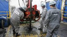 Workers change drilling pipes on the rotary table of a natural gas drilling rig near Towanda, Pennsylvania, February 3, 2010. Energy companies drilling for natural gas in Pennsylvanias Marcellus Shale would have to pay a wellhead tax under a proposal by Gov. Ed Rendell. (TIM SHAFFER/Tim Shaffer/Reuters)
