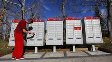 David Nolan a residents of south east Calgary checks for mail in his Canada Post super box in Calgary, Alberta, October 20, 2014. (Todd Korol)