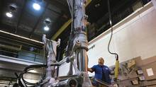 A worker assembles landing gear at the Heroux Devtek facility in Quebec.