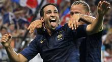 France's Adil Rami (L) and Philippe Mexes celebrate after scoring the winning goal in their friendly soccer game against Iceland leading up to Euro 2012 at Hainaut stadium in Valenciennes, northern France May 27, 2012. REUTERS/Charles Platiau (Charles Platiau/Reuters)