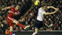 Liverpool's Andy Carroll shoots past Tottenham Hotspur's Michael Dawson during their English Premier League match at Anfield in Liverpool on Feb. 6, 2012. (Phil Noble/Reuters/Phil Noble/Reuters)
