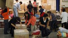 Volunteers at Our Lady of the Assumption church in Toronto are hurrying to fill shipments for typhoon victims. (Fernando Morales/The Globe and Mail)
