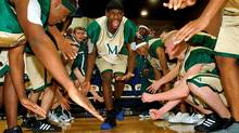 LeBron James (middle) with his teammates from St. Vincent-St. Mary's High School in Akron, Ohio.