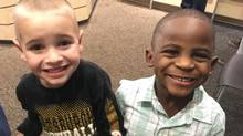 In this Feb. 28, 2017, photo, 5-year-olds Jax, left, and Reddy smile after Jax got a haircut similar to his friend's at the Great Clips in Louisville, Ky. (Debbie Weldon/AP)