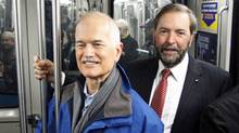 NDP Leader Jack Layton and his deputy, Thomas Mulcair, ride the Montreal metro during the federal election campaign on April 15, 2011. (SHAUN BEST/REUTERS)