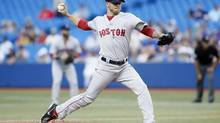 Boston Red Sox starting pitcher Jake Peavy throws against the Toronto Blue Jays in the first inning at the Rogers Centre in Toronto on July 22. (John E. Sokolowski/USA Today Sports)