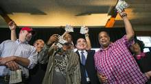 Chinese billionaire Chen Guangbiao stands with men to whom he has given $300 during a lunch he sponsored for hundreds of needy New Yorkers at Loeb Boathouse in New York's Central Park June 25, 2014. (LUCAS JACKSON/REUTERS)