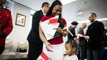 Messia Ditshimba and her three-year-old, Akira, were two of the 30 new citizens sworn in as part of a Canada 150 citizenship ceremony in Vancouver on March 29, 2017. (Rafal Gerszak For The Globe and Mail)