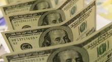 File photo of U.S. dollar bank notes. (Bernadett Szabo)