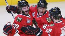 Chicago Blackhawks' Brandon Saad (L) celebrates his goal on the Boston Bruins with teammates Marian Hossa (81) and Jonathan Toews (19) during the second period in Game 1 of their NHL Stanley Cup Finals game in Chicago, Illinois, June 12, 2013. (JIM YOUNG/REUTERS)