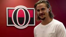 Ottawa Senators defenceman Erik Karlsson makes his way to speak with the media in Ottawa on Monday, August 18, 2014. (Adrian Wyld/THE CANADIAN PRESS)