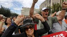 Pensioners shout slogans against the EU and the government during a march towards the EU offices in central Athens in this Oct. 8, 2012 file photo. (Yannis Behrakis/Reuters)