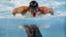 Ryan Lochte of the U.S. competes in the men's 100m butterfly semifinals during the FINA World Swimming Championships in Istanbul December 12, 2012. (MURAD SEZER/REUTERS)